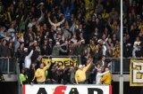 NAC Breda supporters in het Willem II uitvak. Foto: Maurice van Steen