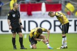 (L-R) referee Bjorn Kuipers, Nemanja Gudelj of NAC Breda, Danny Verbeek of NAC Breda