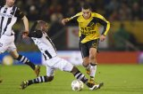 (L-R) Kwame Quansah of Heracles Almelo, Anouar Hadouir of NAC Breda