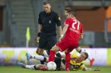 (L-R) referee Tom van Sichem, Felipe Gutierrez of FC Twente, Gilles Swerts of NAC Breda