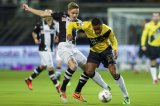 (L-R) Ben Rienstra of Heracles Almelo, Rydell Poepon of NAC Breda