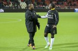 (L-R) Matthew Amoah of Heracles Almelo,  Jeffrey Sarpong of NAC Breda